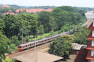 KRL Commuterline - A 10-car 205 series trainset owned by Kereta Commuter Indonesia takes a curve between Universitas Indonesia station and Pondok Cina station on a southbound Commuter Line service in 2016. The 205 series are the current main roster of Kereta Commuter Indonesia, mainly on Red Line, Yellow Line, Blue Line, and Green Line with Bukit Duri and Bogor (both located in Red/Yellow Line) serves as their main depots.