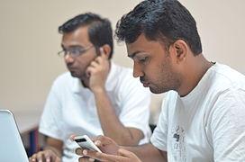 Kannada Wikimedians Kiran Ravikumar and Omshivaprakash during Wikipedia 15 celebration in Bangalore.JPG