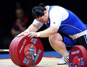 Olympic weightlifting - An Olympic lifter, Jang Mi-ran, holding a barbell loaded with red 25 kg bumper plates, held in place with a collar. Note the lifter's taped wrists and thumbs, her weightlifting shoes, and her weightlifting belt.