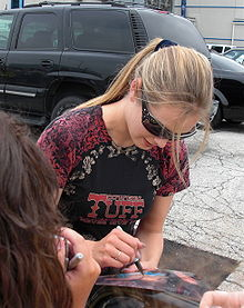 Cook signing autographs during the American Idols LIVE! Tour 2008