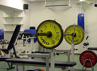 Barbell - An Olympic bar mounted on a bench press bench