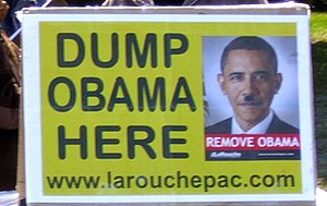 """Views of Lyndon LaRouche and the LaRouche movement - LaRouche supporter sign portraying Barack Obama with a """"Hitler mustache"""""""