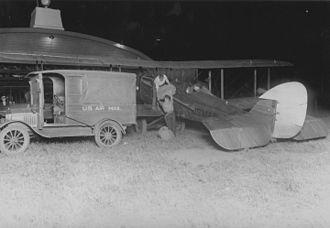Hadley Field - Image: Loading airmail onto de Havilland