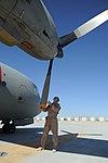 MSG Jason Belcher, of the 538th Air Expeditionary Advisory Squadron, pre-flights an Afghan C-27 Spartan at Kandahar Airfield.jpg