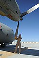 MSG Jason Belcher, of the 538th Air Expeditionary Advisory Squadron, pre-flights an Afghan C-27 Spartan at Kandahar Airfield.jpg