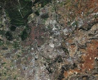 comprises the city of Madrid and twenty surrounding municipalities