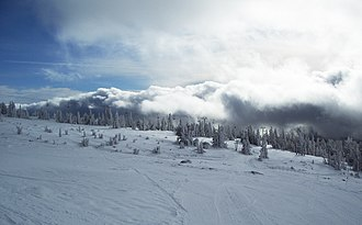 Magic Mile - The present-day Magic Mile chairlift rises out of the clouds and above the tree line