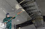 Maintainers clean before painting, inspecting 160104-F-EN010-123.jpg