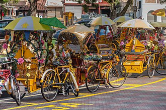 Malacca City - A trishaw service waiting for customers at Stadhuis Red Square