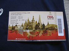 "A ticket with a barcode strip on the right. The ticket is white on top half and red on the bottom, separated by images of the Moscow skyline in gold. In the top left corner is the seat information and the top right has the UEFA Champions League logo and the words ""Final Moscow 2008""."