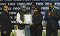 """Manmohan Singh presenting award for excellency to the Executive Director of Zenith Computers Ltd., Mumbai, Ms. Devita Saraf, in the field of """"Corporate Excellence in Small Medium Sector"""".jpg"""