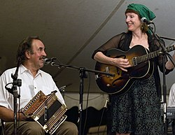 Marc and Ann Savoy playing Cajun accordion and guitar respectively at the Balfa camp.