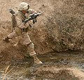 Marine leaps over a stream (4417261334).jpg