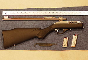 Takedown gun - 2008 Marlin Model 70PSS, disassembled, with ruler for scale