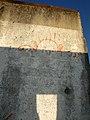 Mauerteil mit Kilroy von der Berliner Sonnenallee an der Castellbergstraße in Ballrechten-Dottingen 2.jpg