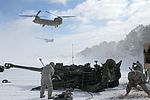 Michigan National Guard conducts cold weather sling load and howitzer live fire exercise 140301-Z-LE308-039.jpg