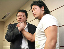 Mitsuharu Misawa and Go Shiozaki on May 6, 2009.jpg