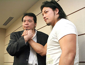 Mitsuharu Misawa - Misawa along with Go Shiozaki (right) in May 2009.