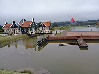 Architecture of the Netherlands - View of the Carambeí Historical Park mill and houses in Dutch architecture on the left