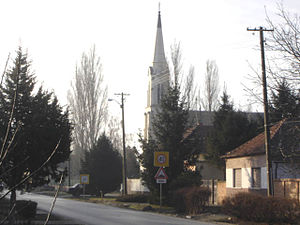 Mužlja - Main street and the Catholic Church