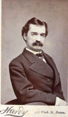 Mustachioed man by Hardy of 493 Washington Street in Boston.png