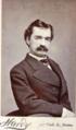 Mustachioed man by Hardy of 493 Washington Street in Boston.png