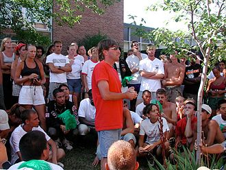 Santa Clara Vanguard Drum and Bugle Corps - Then visual designer and mentor, Myron Rosander addressing the 2001 corps. Age-outs are shown holding their green feathers.
