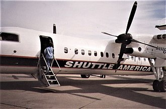 Shuttle America - N801SA boards at Bradley International Airport (BDL) to Wilmington, DE (ILG) in 1999.