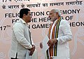 Narendra Modi with the Minister of State for Skill Development, Entrepreneurship, Youth Affairs and Sports (Independent Charge), Shri Sarbananda Sonowal, at the Felicitation Ceremony of medal winners of the 17th Asian Games.jpg