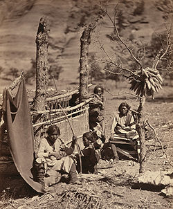 Navajo family with loom