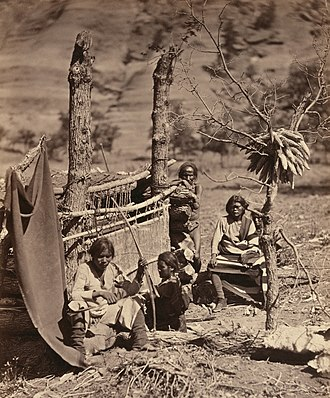 Fort Defiance, Arizona - Navajo family with loom. Near Old Fort Defiance, New Mexico. Albumen print photograph, 1873.