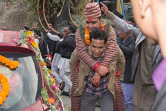 Culture of Nepal - Procession of Nepali Hindu Wedding; Groom being carried by a bride brother or relatives