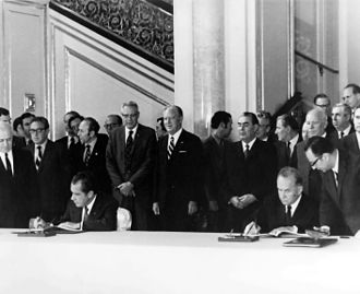 Apollo–Soyuz Test Project - U.S. President Richard Nixon and Soviet Premier Alexei Kosygin (seated) sign an agreement paving the way for the Apollo–Soyuz flight, May 1972.