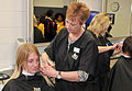 Pam Kiesgen, right, cuts the hair of U.S. Navy recruit Chelsea Murphy inside the Golden 13 Recruit Inprocessing Center's Navy Exchange Barber Shop at Recruit Training Command (RTC) at Naval Station Great Lakes 121120-N-IK959-846.jpg