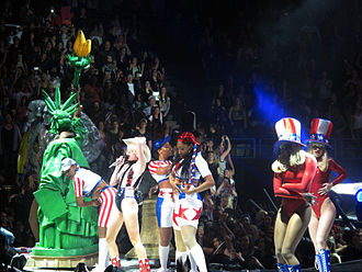 "Party in the U.S.A. - Cyrus performing ""Party in the U.S.A."" during the Bangerz Tour, alongside various Americana references, including Mount Rushmore, the Statue of Liberty and the Liberty Bell"