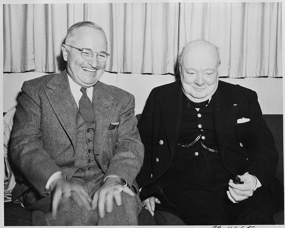 Photograph of President Truman sharing a laugh with British Prime Minister Winston Churchill aboard the President's... - NARA - 199016