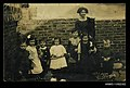 Photographic postcard of a female teacher with her kindergarten class at Miss Capon's Private School in Southsea, Portsmouth (10279281605).jpg