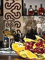 Plate of fruits with a glass of wine.jpg