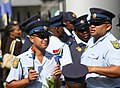 Police officers with national flags of South Africa.jpg