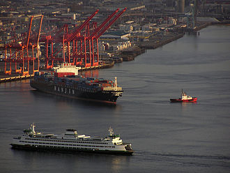 Port of Seattle - A container ship and the Bainbridge Island ferry near Terminal 46