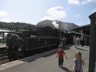 Cambrian Coast Express - The Cambrian headed by BR standard class 4 2-6-0 No.76079 awaits to depart Porthmadog station, August 2009