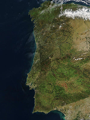 Geography of Portugal - Hot, dry conditions sparked dozens of devastating wildfires in northern and central Portugal and central Spain in the summer of 2003. By the time this image was taken on January 19, 2004, the scars had begun to fade in areas, though the scars in Central Portugal and across the border in Spain are still dark red in the false-color image.