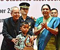 Pranab Mukherjee presented Dr. A.P.J. Abdul Kalam IGNITE Awards to creative children, at the Institute of Management – Ahmadabad (IIMA), in Gujarat. The Chief Minister of Gujarat, Smt. Anandiben Patel is also seen (1).jpg