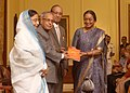 Pranab Mukherjee receiving a copy of book ''The First Woman President of India Reinventing Leadership, Smt. Pratibha Devisingh Patil' from the Speaker, Lok Sabha, Smt. Meira Kumar, at Rashtrapati Bhavan.jpg