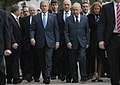 President George W. Bush walks with Israel's President Shimon Peres, right, and Prime Minister Ehud Olmert.jpg