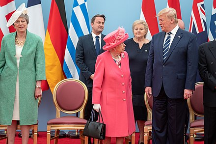 May with Queen Elizabeth II, U.S. President Donald Trump and other world leaders to mark the 75th anniversary of D-Day on 5 June 2019 President Trump and First Lady Melania Trump's Trip to the United Kingdom (48007770612).jpg