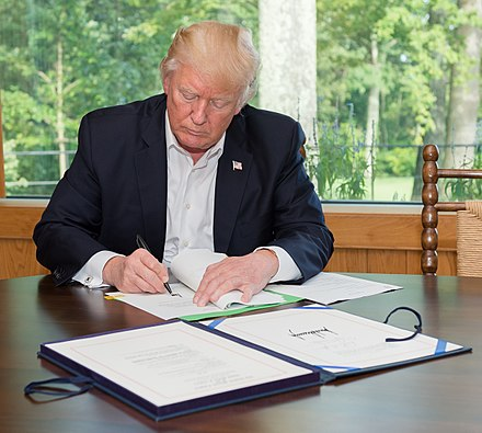 President Trump signs H.R. 601 into effect, providing $15 billion in disaster relief for hurricane victims President Trump signing Hurricane Harvey bill (cropped).jpg