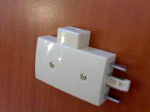 Protea (telephone) - Adapter to plug an RJ11 plug into an old Protea telephone jack