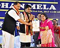 Rajiv Pratap Rudy and the Minister of State for Heavy Industries & Public Enterprises, Shri Babul Supriyo presented the the certificates at the inauguration of the DigiDhan Mela, in Agartala.jpg