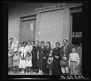 Museo de la Masacre de Ponce - Photo showing the machine gun bullet-ridden Casa de la Masacre building, with relatives of Nationalists killed in the Ponce massacre.